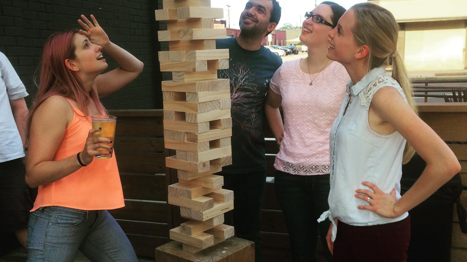 NGP students play Jenga at a happy hour event